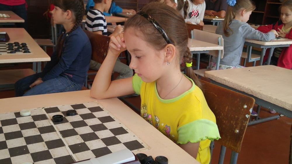 Маленькие каменчане соревновались за звание чемпиона города по шашкам, фото-3